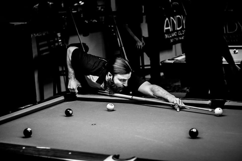 Dr. Dave Schroerlucke playing pool