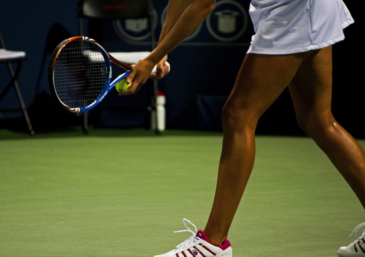 tennis athlete preparing to serve
